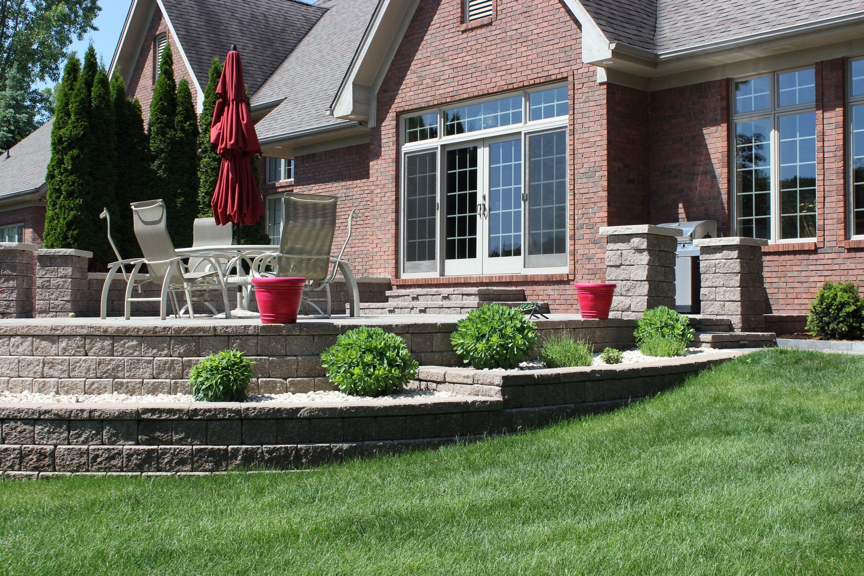 Exterior, rear landscaping project that was conceptualized with a 3D design program, U-vision.